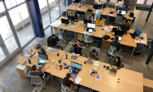 Employees sitting at their desks with their laptops